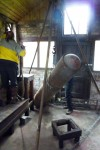 Raisng the WWI torpedo casing which will store compressed air for starting